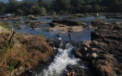Crossing the River at Thumburmoozhi at Kerala
