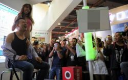 Crazy World: Model feeds guy milk straight from her mouth at Guangzhou Sex Culture Festival