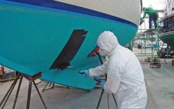 A man was asked to paint a boat.