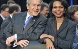 George W. Bush is chatting with Condoleeza Rice